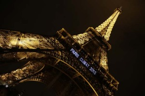 """Lights on the Eiffel Tower read, """"Paris Climat 2015"""" to mark the selection of the French capital to host the United Nations Climate Change Conference in 2015"""